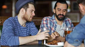 Happy male friends drinking beer at bar or pub stock video
