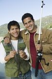 Happy Male Friends Fishing Together Royalty Free Stock Photo