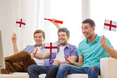 Happy male friends with flags and vuvuzela Stock Photos