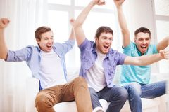 Happy male friends at home Stock Image