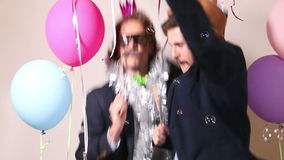 Happy male friends jumping in photo booth stock video