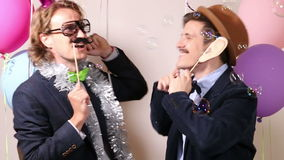 Happy male friends in photo booth stock video