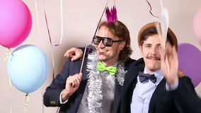 Happy male friends in photo booth stock footage