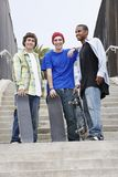 Happy Male Friends With Skateboards Stock Photography