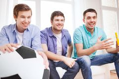 Happy male friends with vuvuzela Stock Photo
