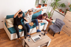 Happy male friends watching a game Royalty Free Stock Image