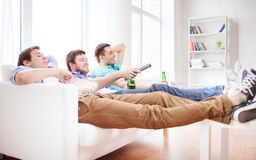 Happy Male Friends With Beer Watching Tv At Home Stock Photos