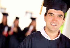 Happy male graduate Stock Photos