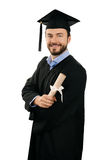 Happy male graduate with diploma isolated on white Stock Photography