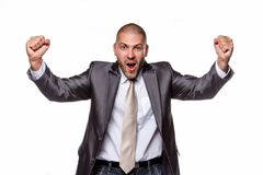 Happy male in a grey suit. Happy male in a grey suit isolated on a white background Stock Photography
