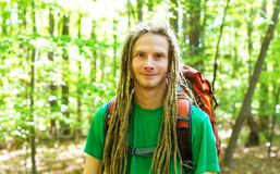 Happy male hiker with backpack. Trekking through the forest Royalty Free Stock Images