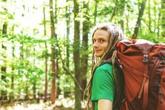 Happy male hiker with backpack. Trekking through the forest Stock Photography