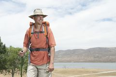 Happy Male Hiker Looking Away Royalty Free Stock Photography