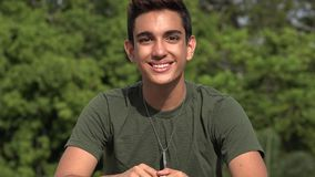 Happy Male Hispanic Teenage Soldier Recruit. A handsome hispanic male teen stock video footage