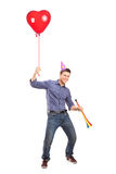 Happy male holding a balloon Stock Photo