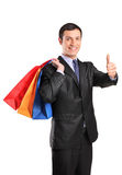 A happy male holding shopping bags Royalty Free Stock Image