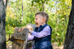 Happy Male Kid Playing at the Woods Royalty Free Stock Images