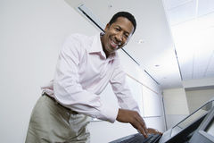 Happy Male Lecturer Using Computer Stock Photo