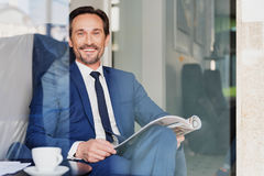 Happy male manager relaxing in cafeteria Royalty Free Stock Photo