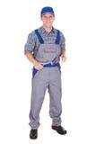 Happy male mechanic holding ratchet Royalty Free Stock Images