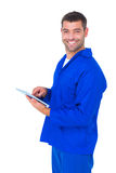 Happy male mechanic using tablet computer Royalty Free Stock Photography