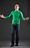 Happy male model, clapping hands. Studio portrait of a happy male model, clapping hands Royalty Free Stock Photography