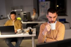 Happy male office worker drinking coffee royalty free stock images