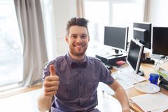 Happy male office worker showing thumbs up Royalty Free Stock Photography