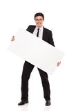Happy male office worker standing with placard. Stock Images