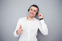 Happy male operator showing thumb up Stock Photography