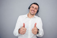 Happy male operator showing thumbs up Royalty Free Stock Image