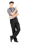 Happy male painter holding a paintbrush Royalty Free Stock Photography
