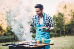 Happy male preparing bbq meat Royalty Free Stock Image