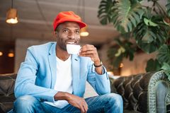 Happy male relaxing with cup of coffee Royalty Free Stock Photo
