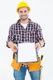 Happy male repairman showing clipboard Royalty Free Stock Images