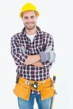 Happy male repairman wearing tool belt Stock Image