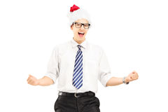 Happy male with santa hat gesturing happiness Royalty Free Stock Photography