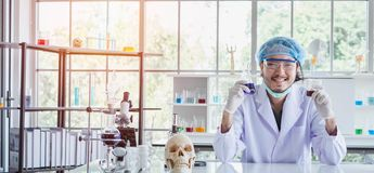 A happy male scientist showing the successful results of his experiment in a science lab. Where there are chemical substances and equipment. Scientist concept royalty free stock photo