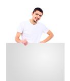 Happy male standing by white blank card Royalty Free Stock Image