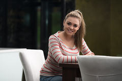 Happy Male Student In Cafeteria. Young Female Student Drinking Cafe In Cafeteria Royalty Free Stock Photos