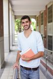 Happy male student. Holding books smile to you, caucasian Royalty Free Stock Photography