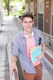 Happy male student. Holding books smile to you, caucasian Stock Photos