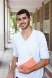 Happy male student. Holding books smile to you, caucasian Stock Images
