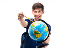 Happy male student holding globe Royalty Free Stock Images