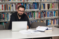Happy Male Student With Laptop In Library Royalty Free Stock Photos