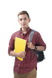 Happy male student smiling - isolated over a white background. Happy male student smiling holding books - isolated over a white background Stock Photo
