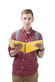 Happy male student smiling - isolated over a white background. Happy male student smiling holding books - isolated over a white background Stock Photography