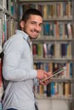 Happy Male Student Working With Laptop In Library Stock Photos