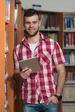 Happy Male Student Working With Laptop In Library Stock Image