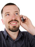 Happy male talking to mobile phone. Happy young adult Caucasian man. Holding a mobile phone and talking Stock Image